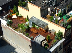 An aerial view in Manhattan of a rooftop deck designed by all decked out nyc