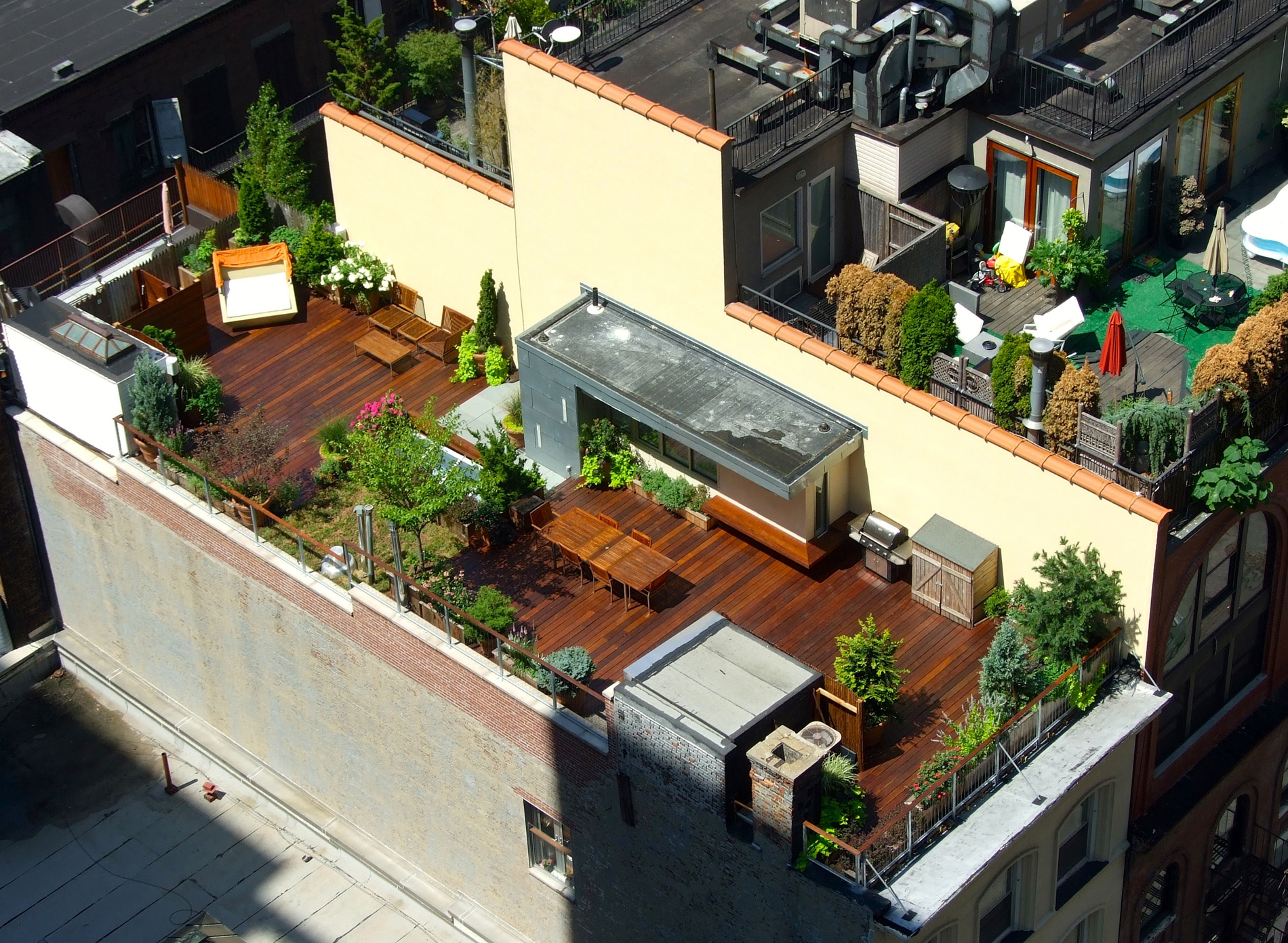an aerial view in manhattan of a rooftop deck designed by all decked out nyc - Rooftop Deck Design Ideas