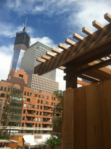 A custom built arbor on a rooftop terrace in NYC with the Freedom Tower in the background