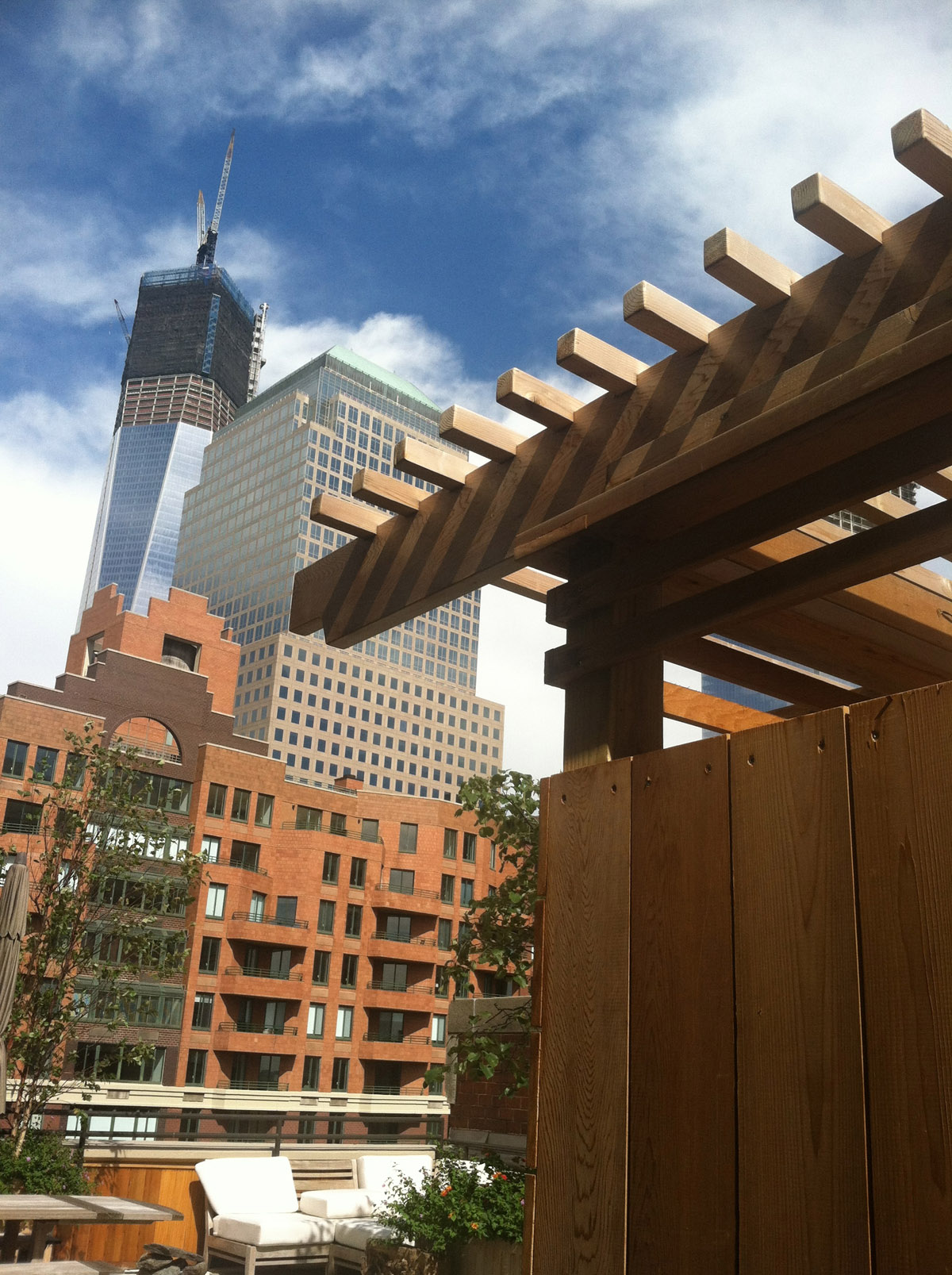 A Custom Built Arbor On A Rooftop Terrace In NYC With The Freedom Tower In  The
