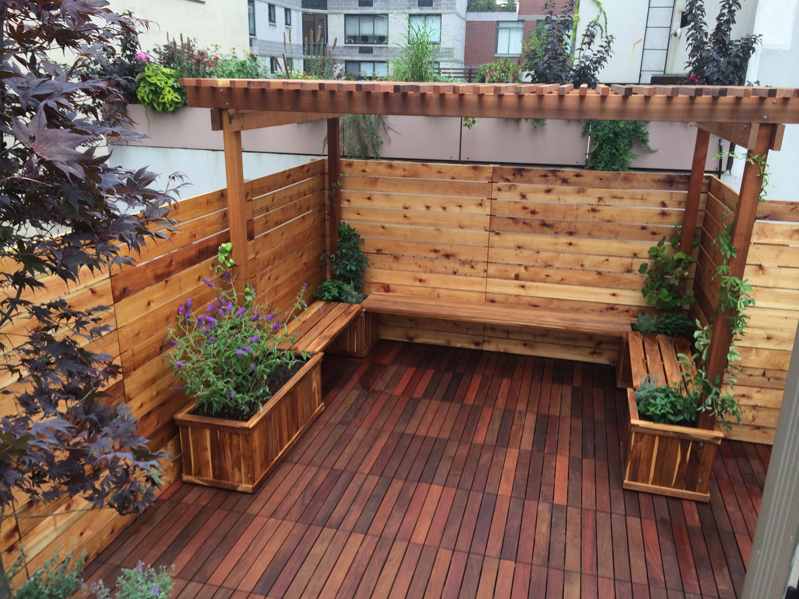 A custom built arbor and privacy fence on a rooftop garden in Manhattan