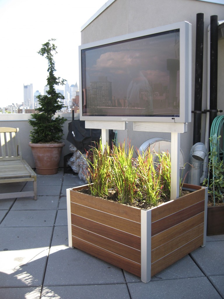 Outdoor flat screen television and home theater on a rooftop terrace in NYC