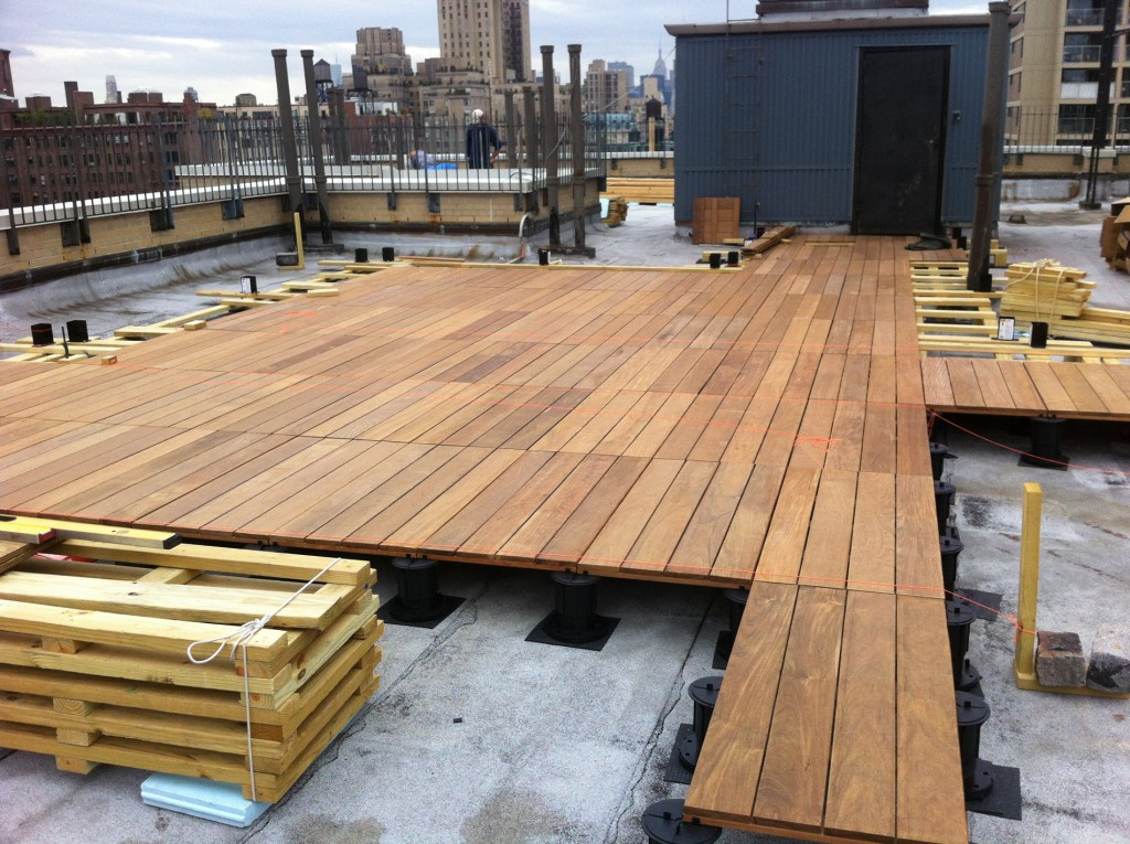 A pedestal decking system being installed on a rooftop in Manhattan.