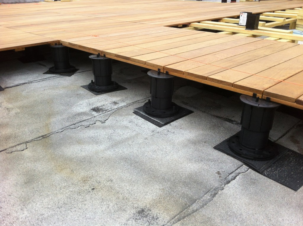 Pedestal Decking system detail of struts holding deck to elevation on roof
