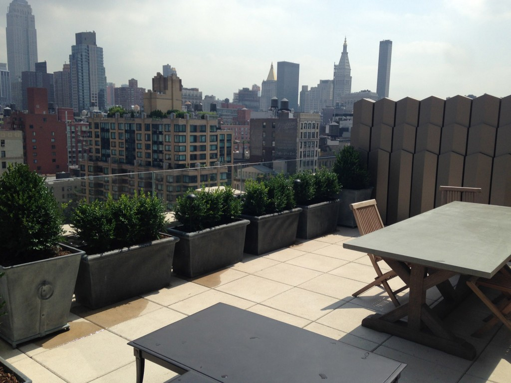 Concrete polished pavers on rooftop deck in Manhattan