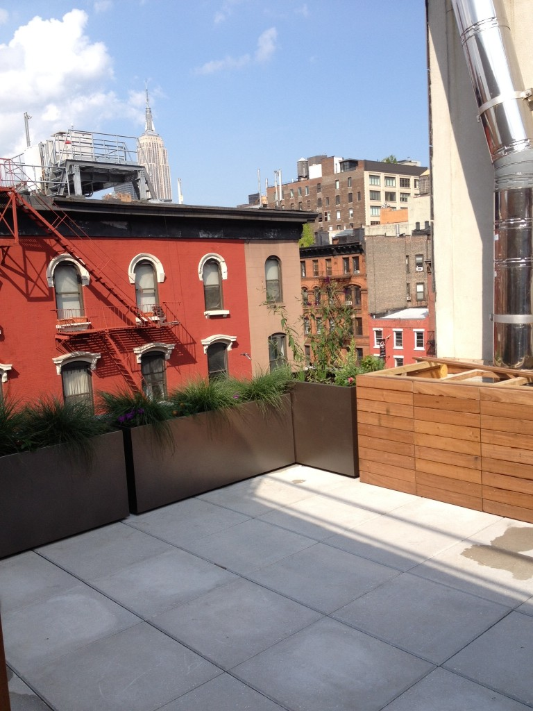 Lower east side rooftop deck with concrete pavers