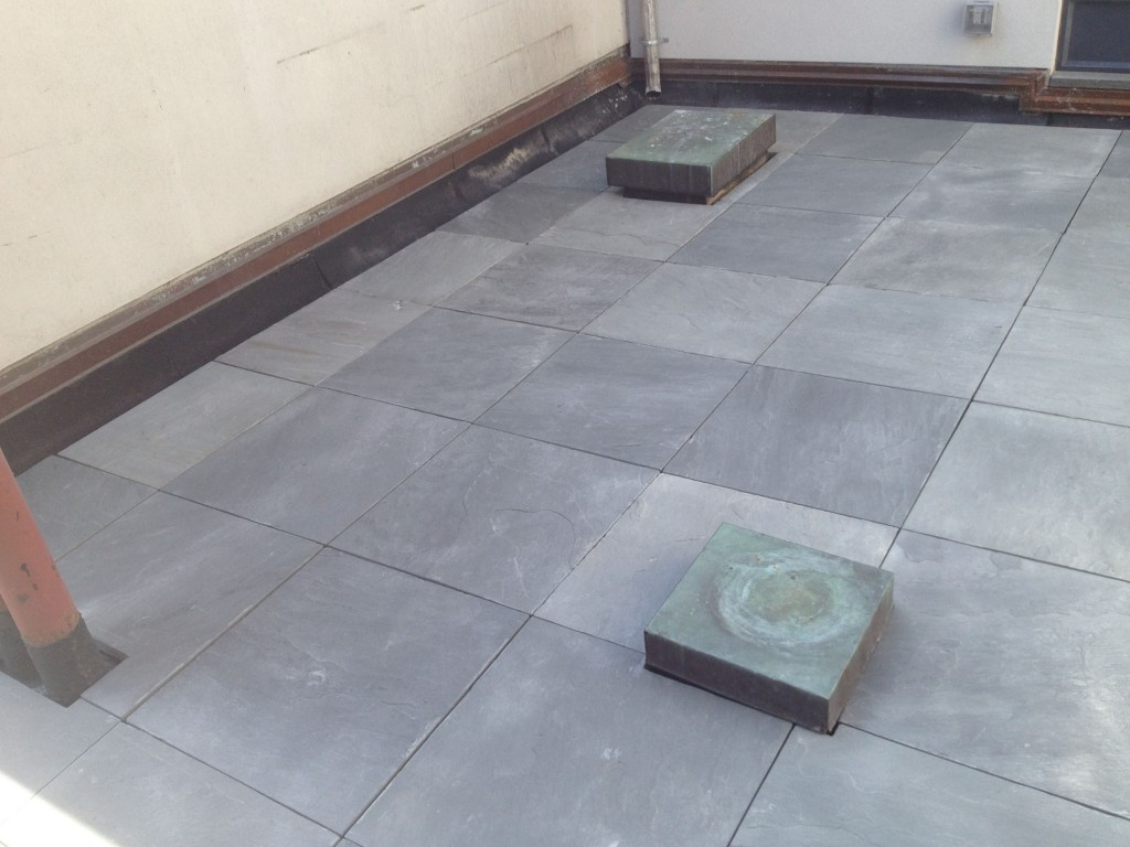 Bluestone pavers on a pedestal decking system on a rooftop in NYC.