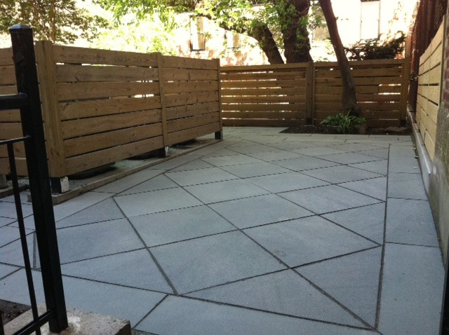 Bluestone patio in geometric pattern.