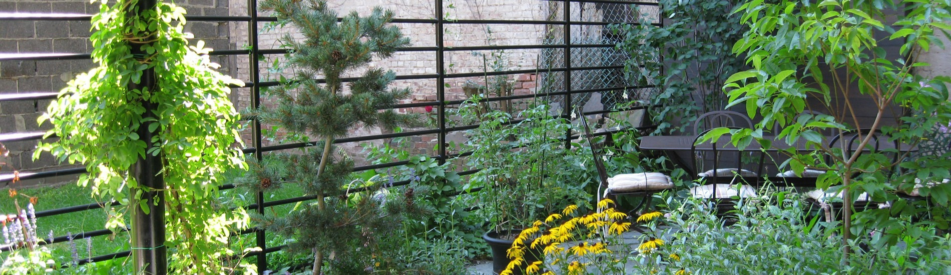 Private backyard garden in Brooklyn NY. Designed by All Decked Out NYC.